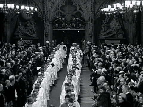 a procession of choir boys and religious officials move past the congregation in westminster abbey for the wedding of princess elizabeth and the duke... - religiöse kleidung stock-videos und b-roll-filmmaterial