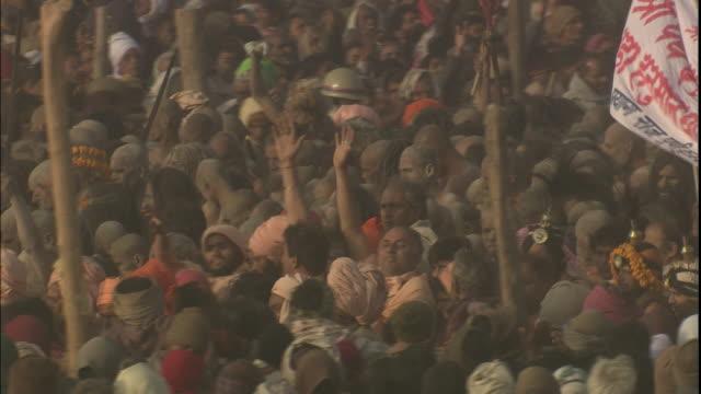 Procession of decorated Sadhus parade through large crowd of Kumbh Mela pilgrims, Allahabad, Uttar Pradesh, India