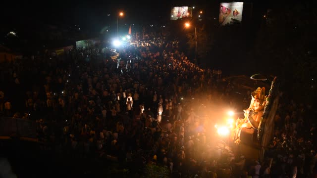 procession of lord ganesha. amravati, india. - maharashtra stock-videos und b-roll-filmmaterial