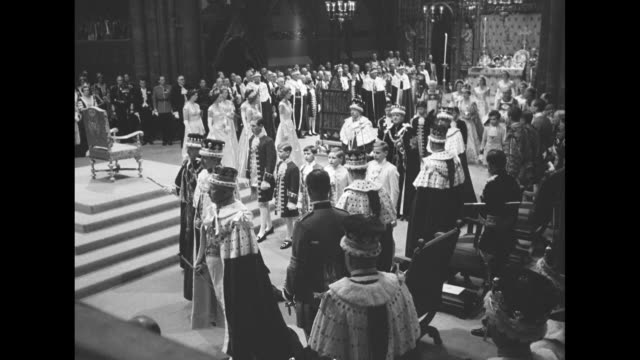 procession of queen elizabeth ii in main sector of westminster abbey passes coronation chair after coronation ceremony / medium close up of elizabeth... - coronation of queen elizabeth ii stock videos and b-roll footage