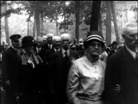 B/W 1927 procession of senior couples at Elderly Convention / newsreel