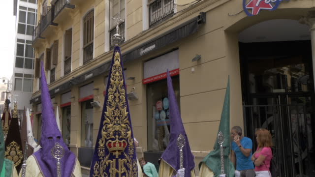 procession of the brotherhoods on easter sunday, malaga, andalucia, spain, europe - three quarter length stock videos & royalty-free footage