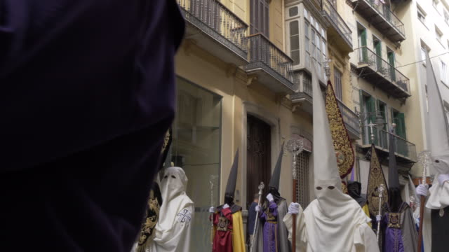 procession of the brotherhoods on easter sunday, malaga, andalucia, spain, europe - robe stock videos & royalty-free footage
