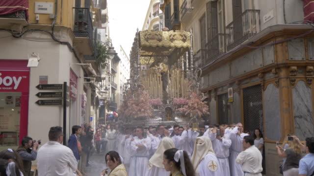 vídeos de stock e filmes b-roll de procession of the brotherhoods on easter sunday, malaga, andalucia, spain, europe - cultura espanhola