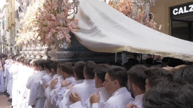procession of the brotherhoods on easter sunday, malaga, andalucia, spain, europe - happy easter stock-videos und b-roll-filmmaterial