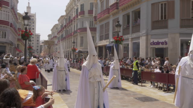 stockvideo's en b-roll-footage met procession of the brotherhoods on easter sunday, malaga, andalucia, spain, europe - easter