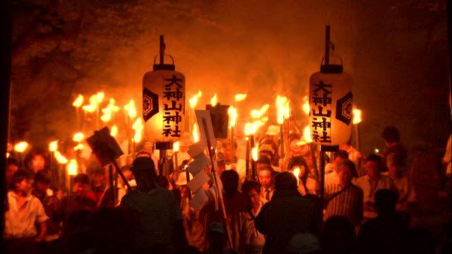 procession of torches led by man carrying lantern, japan - traditionell festival stock-videos und b-roll-filmmaterial