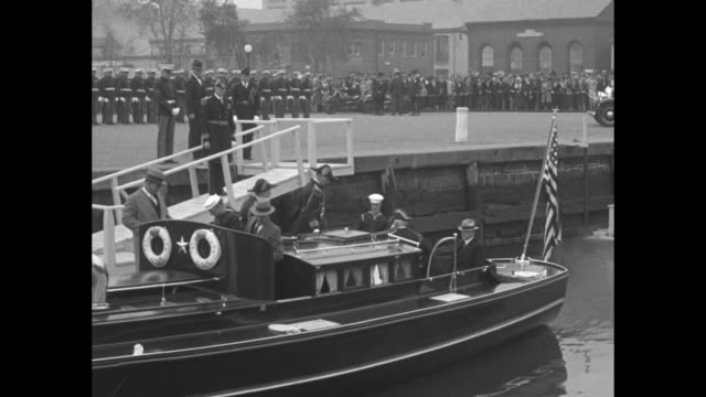 procession of us navy officers walks down plank to motor launch followed by pres herbert hoover and first lady lou hoover other civilian officials... - uss constitution stock videos and b-roll footage