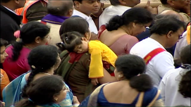 procession outside new shri venkateswara hindu temple **hindu religious music heard over following sequence sot** crowd of hindu pilgrims following... - religious music stock videos and b-roll footage