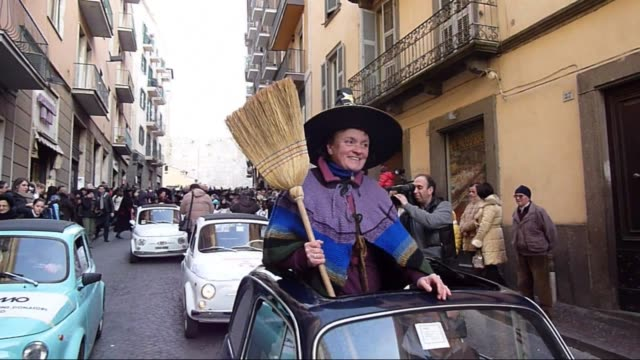a procession to mark the christian festival of epiphany in which a witch brings presents and sweets to wellbehaved children sees a 52metre long... - witch stock videos & royalty-free footage