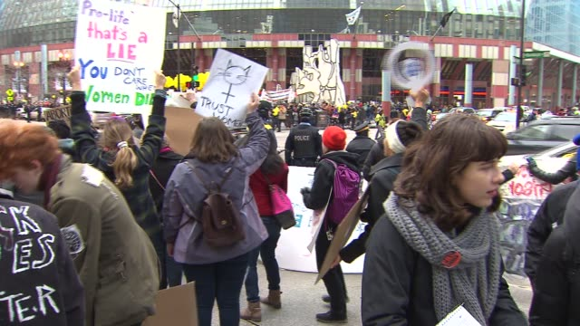 prochoice activists at a rally in downtown chicago on jan 18 2015 - contraceptive stock videos & royalty-free footage