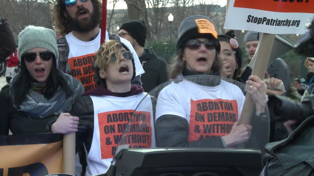 Prochoice activists chant from behind a police blockade at the March for Life