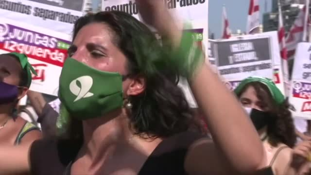 pro-choice activists gather outside argentina's congress building in the capital buenos aires as a polarized senate begins a debate on legalizing... - refraction stock videos & royalty-free footage