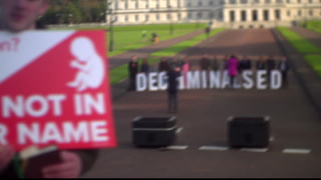 prochoice and prolife protesters outside stormont after abortion was made legal in northern ireland - ストーモント点の映像素材/bロール