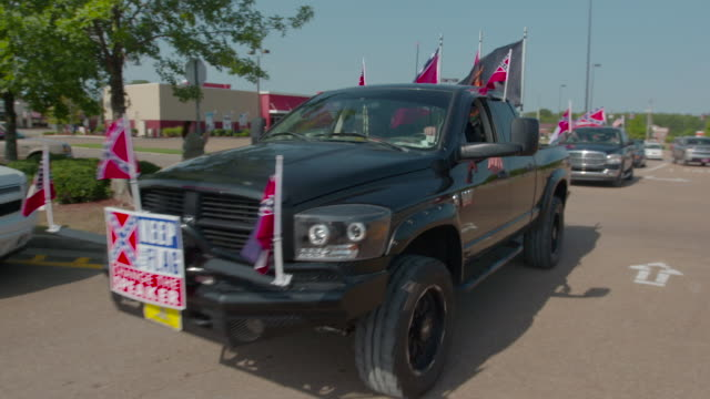 pro-confederate flag truck drives by, medium shot - confederate flag stock videos & royalty-free footage