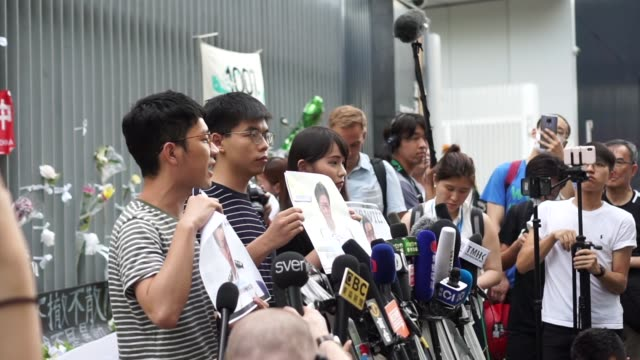 prodemocracy activists nathan law joshua wong and agnes chow holding a news conference on 18 june 2019 outside the legislative council building hong... - campaigner stock videos & royalty-free footage