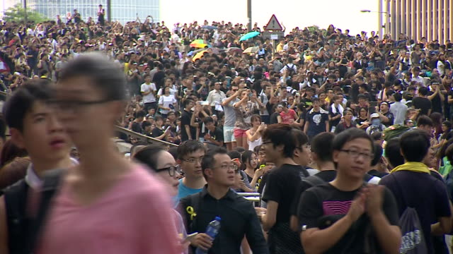 prodemocracy demonstrators line the streets of hong kong's financial district during the day - editorial stock videos & royalty-free footage