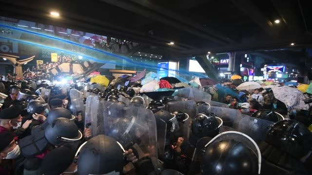 pro-democracy protesters face off against riot police during an anti-government rally near pathum wan intersection october 16, 2020 in bangkok,... - thailand stock videos & royalty-free footage