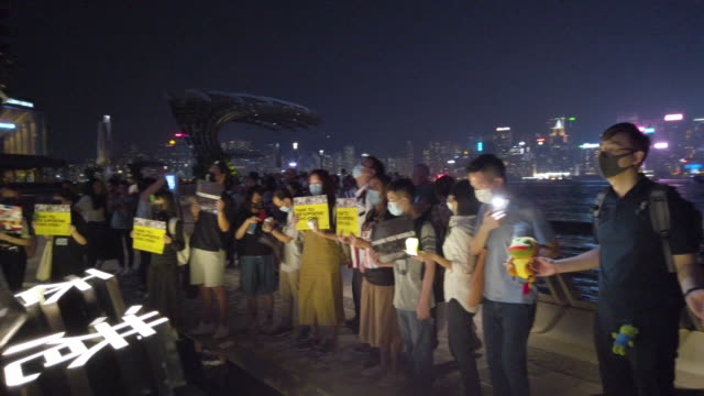 prodemocracy protesters form a pepe the frog themed human chain from tsim sha tsui to prince edward on september 30 2019 in hong kong china - tsim sha tsui stock videos & royalty-free footage