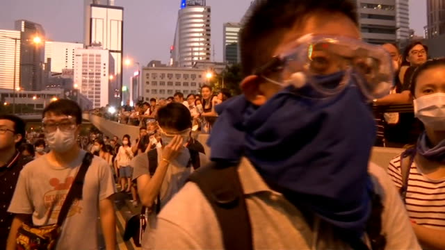 Prodemocracy protesters stage mass blockade in Hong Kong CHINA Hong Kong EXT Riot police with helmet and gas masks Protesters shouting PAN line up of...
