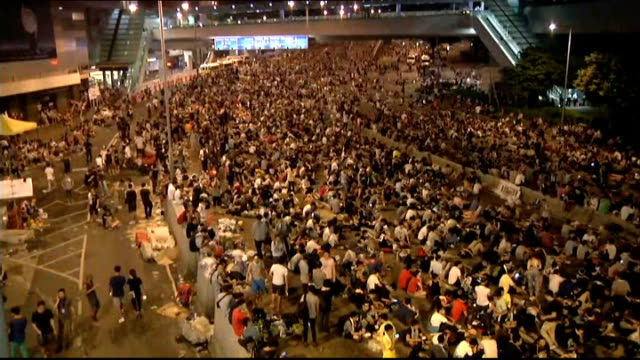 prodemocracy protesters stage mass blockade in hong kong demonstrators on street protester sitting on the road - 2014 stock videos & royalty-free footage