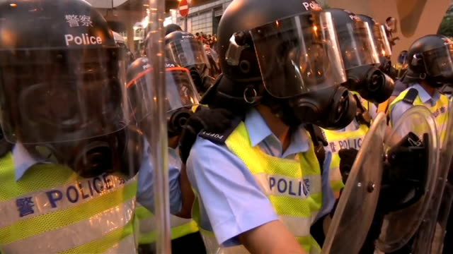 prodemocracy protesters stage mass blockade in hong kong protesters along street after tear gas had cleared various of demonstrators confronting line... - occupy central stock videos & royalty-free footage