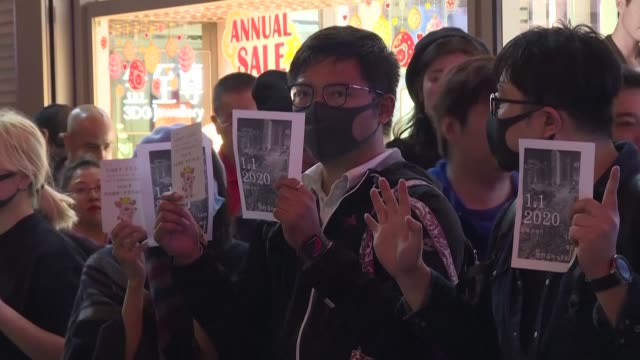 prodemocracy protesters take their movement into the new year forming a human chain in hong kong's neighborhood of tsim sha tsui - tsim sha tsui stock videos & royalty-free footage