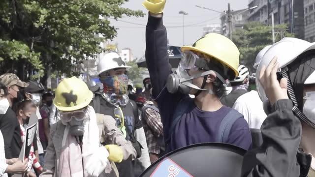pro-democracy protestors clashing with riot police in yangon, myanmar - protestor stock videos & royalty-free footage