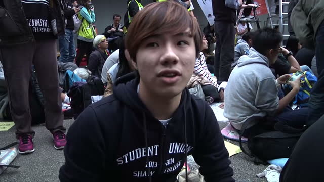 prodemocracy protestors in hong kong say their fight for free elections will continue after police cleared a huge protest site in the admiralty... - protestor stock videos & royalty-free footage