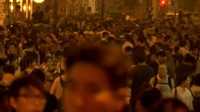 Prodemocracy protests continue in Hong Kong EXT GVs ProDemocracy campaigners shining torches in crowd 'Sorry for the inconvenience we are trying to...