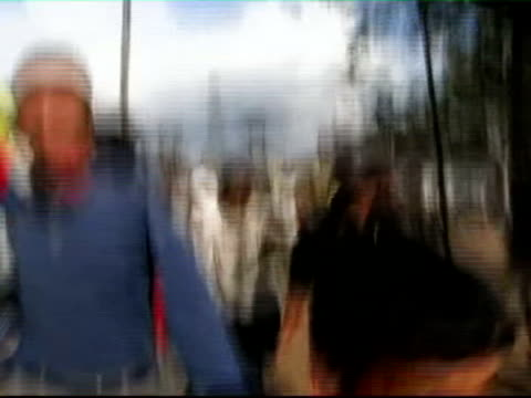 security forces fired on demonstrators defying curfew nepal karlanki ext protesters running away across field track forward as shouting sot... - police line up stock videos and b-roll footage