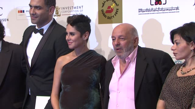 producer mohamed samir, actors hany adel, yasmin raes, director mohamed khan and screenwriter wessam soliman at 'the factory girl' red carpet at... - scriptwriter stock videos & royalty-free footage