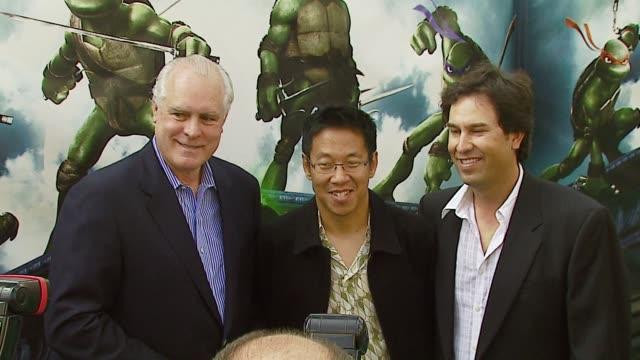 producer thomas k gray, producer paul wang and producer h galen walker at the 'teenage mutant ninja turtles' world premiere at grauman's chinese... - ミュータント・タートルズ点の映像素材/bロール