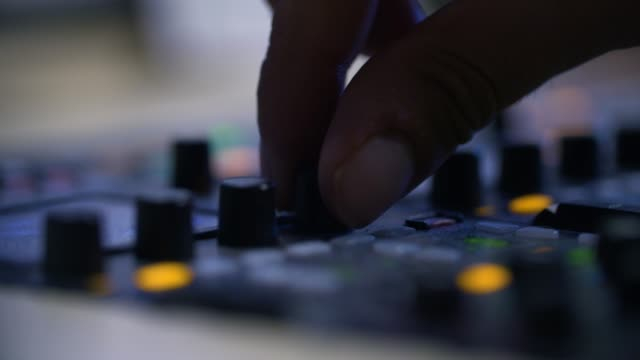 producer working with control desk in studio - sala di controllo video stock e b–roll