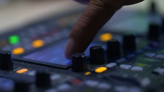 producer working with control desk in studio - pannello di controllo video stock e b–roll