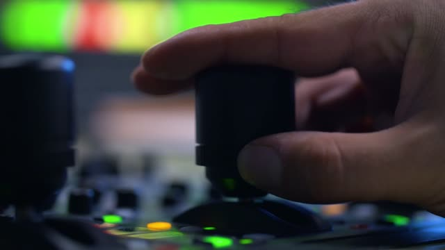 producer working with control desk in studio - broadcasting stock videos & royalty-free footage