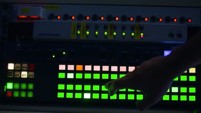 producer working with control desk in studio - performing arts event stock videos and b-roll footage