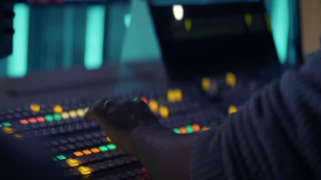 producer working with control desk in tv studio - broadcasting stock videos & royalty-free footage