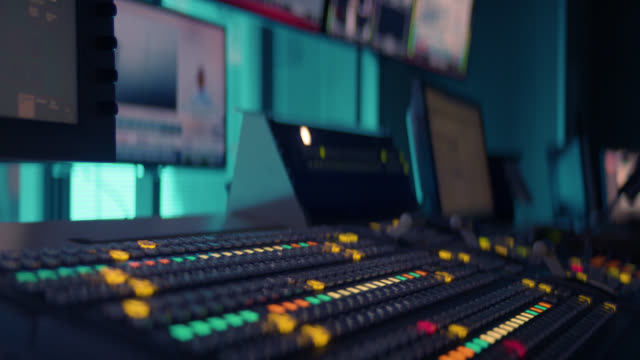 producer working with control desk in tv studio - television studio stock videos & royalty-free footage