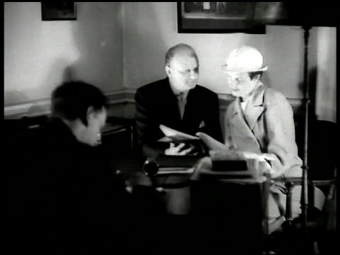 producers brock pemberton in office w/ actor don golden seated at desk guthrie mcclintock seated in office - 1935 stock-videos und b-roll-filmmaterial