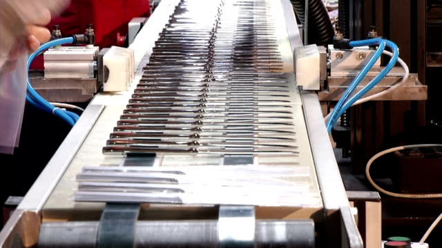 production and packaging cutlery - eating utensil stock videos and b-roll footage