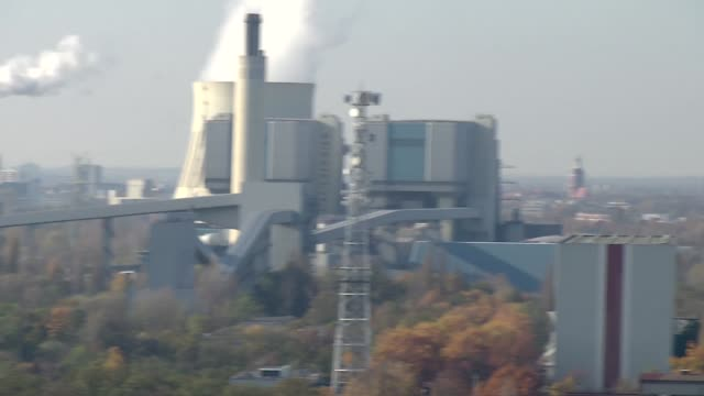 production halls in berlin suburbs - smoke stack stock videos & royalty-free footage