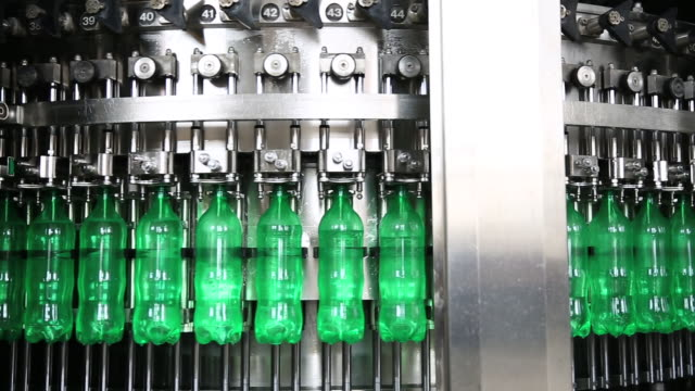 production line of carbonated drinks - filling stock videos & royalty-free footage