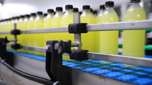 production line of carbonated drinks - food processing plant stock videos & royalty-free footage