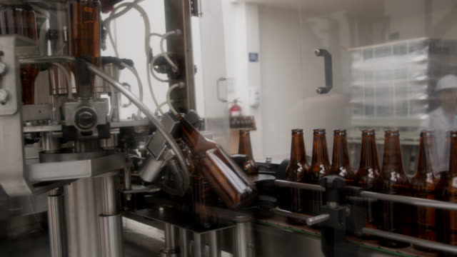 production of bottles on automated machine on process to be filled with beer - bottling plant stock videos & royalty-free footage