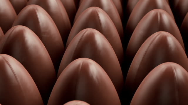 production of easter eggs in the chocolate factory - shape stock videos & royalty-free footage