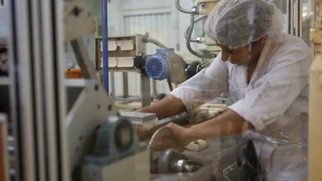 production of milk twirled chocolate in the chocolate factory del turista in bariloche in patagonia workers can be seen as well who are cleaning the... - chocolate milk stock videos & royalty-free footage