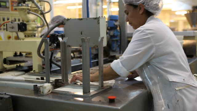 Production of milk twirled chocolate in the Chocolate factory 'Del Turista' in Bariloche in Patagonia workers can be seen as well who are cleaning...