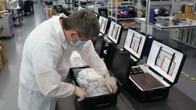production of portable mini laboratories with the isothermal genetic test smartamp technology for fast covid-19 testing at an assembly facility,... - russia点の映像素材/bロール
