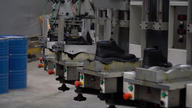 production of working boots at a shoe factory - footwear stock videos & royalty-free footage